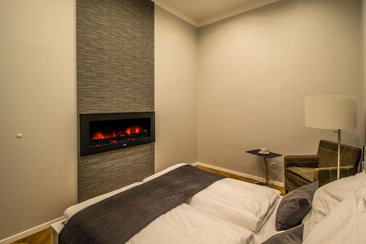 3D fire place in the 1st bedroom will make you stay not only cozy, but also very warm!