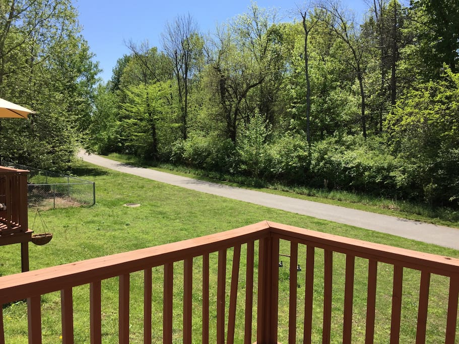 Deck and view of walking/jogging trail behind property