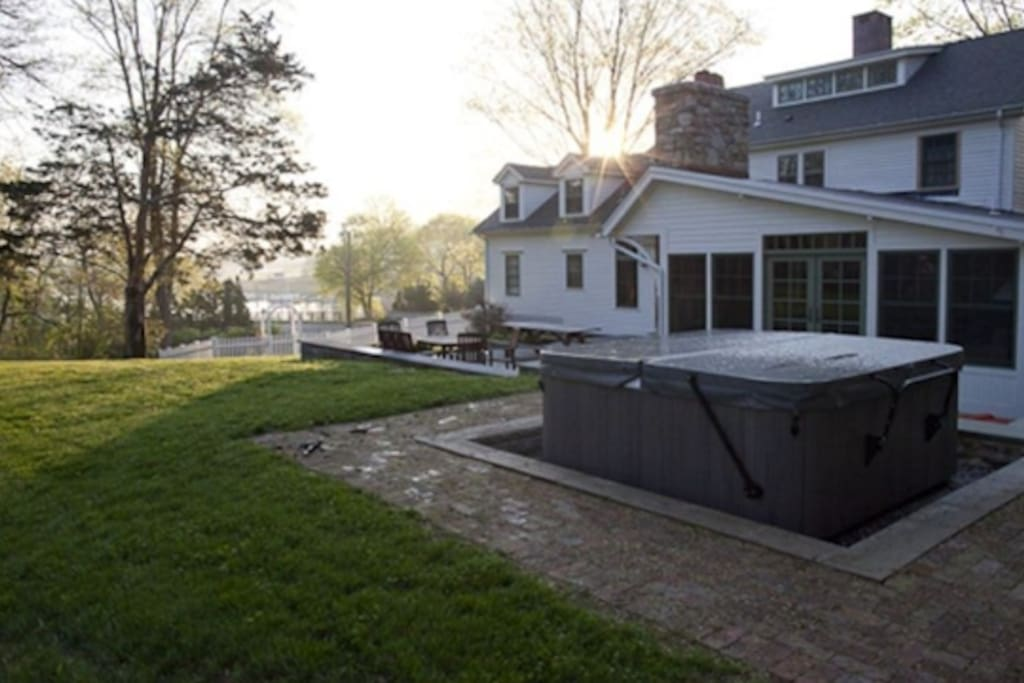 view of the backyard and hot tub.