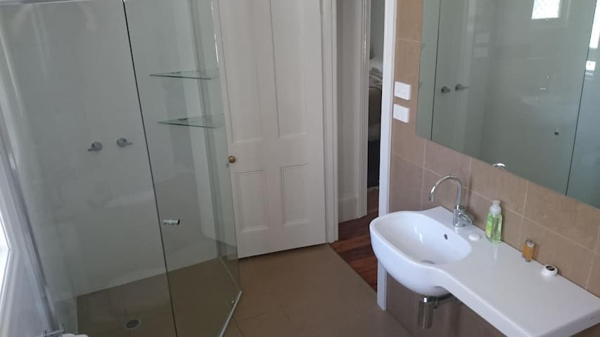 Your bathroom is new, spacious and modern with separate bath and shower.