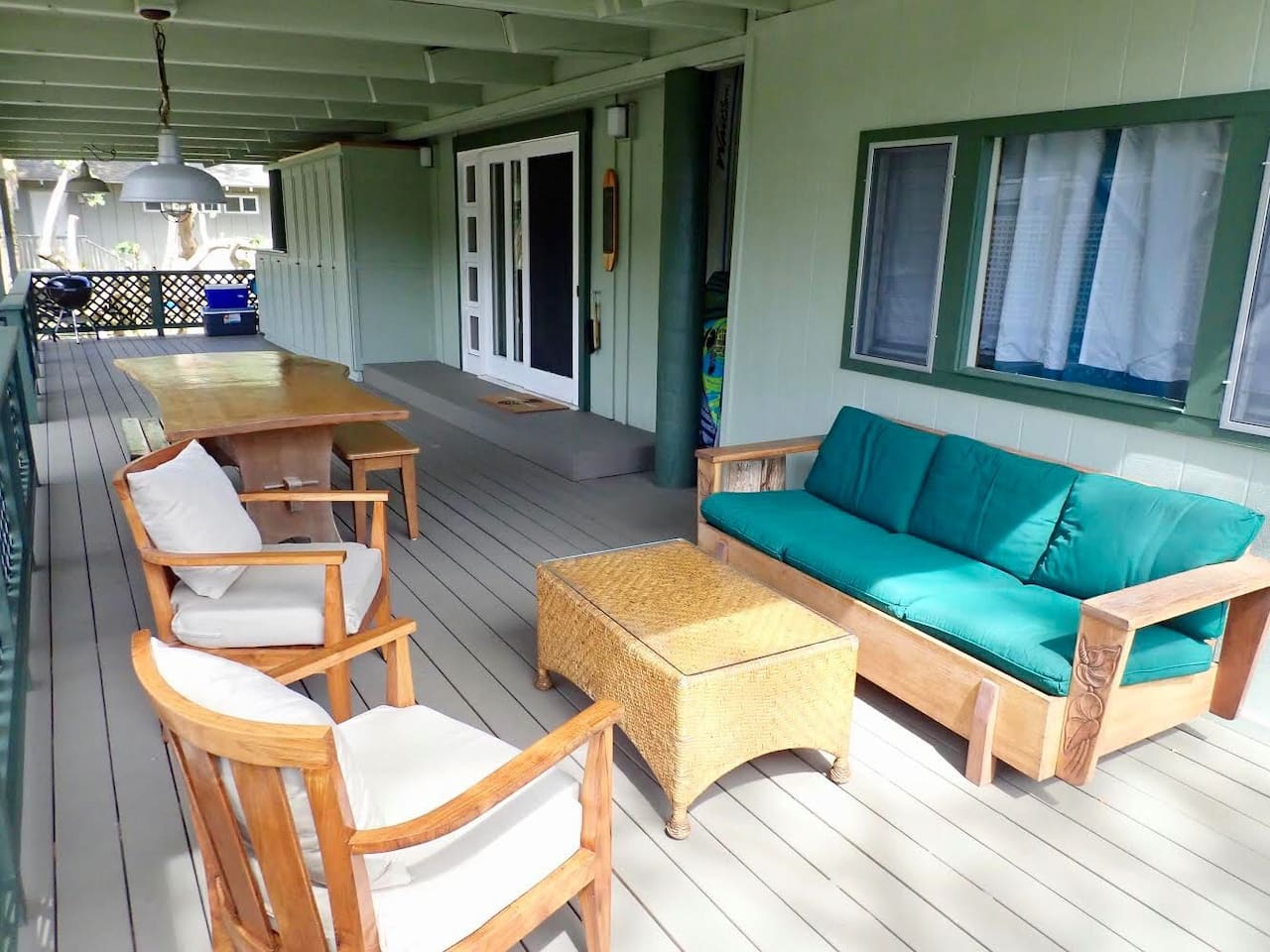 Our leeward lanai with comfortable seating and outdoor dining table.  Washer/dryer is in the cabinet on the far end.