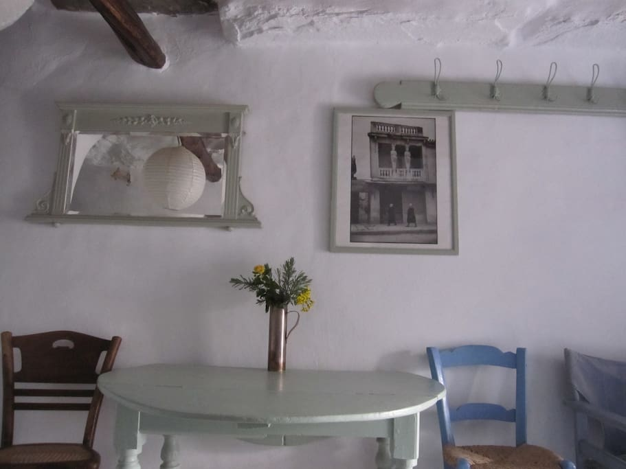 The dining table, with a photo behind by Henri  Cartier Bresson of an historic building in   Athens, also once painted by his friend, Greece's famous artist Giannis Tsarouchis.