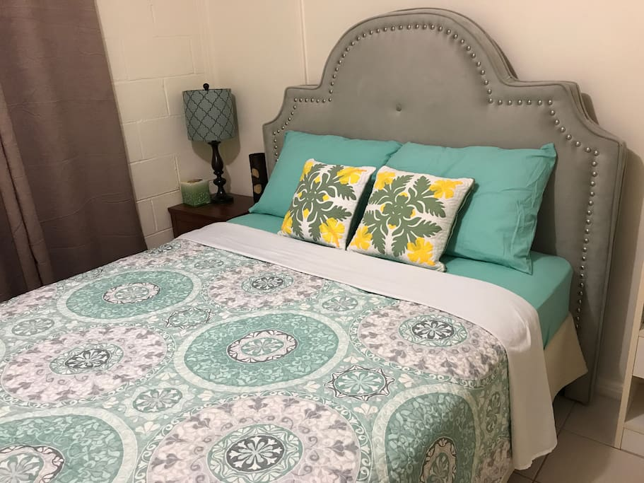 Queen Bed - View 2 We change the bedsheets colors/designs to compliment every new guest.