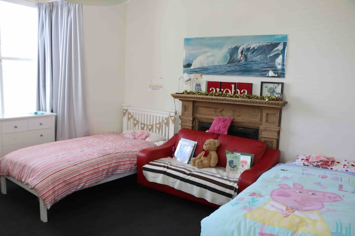 Large spacious room. Two king single beds. Quality pillow top mattresses. Pull out trundler bed if required.  All new bedding in place for guest visits.