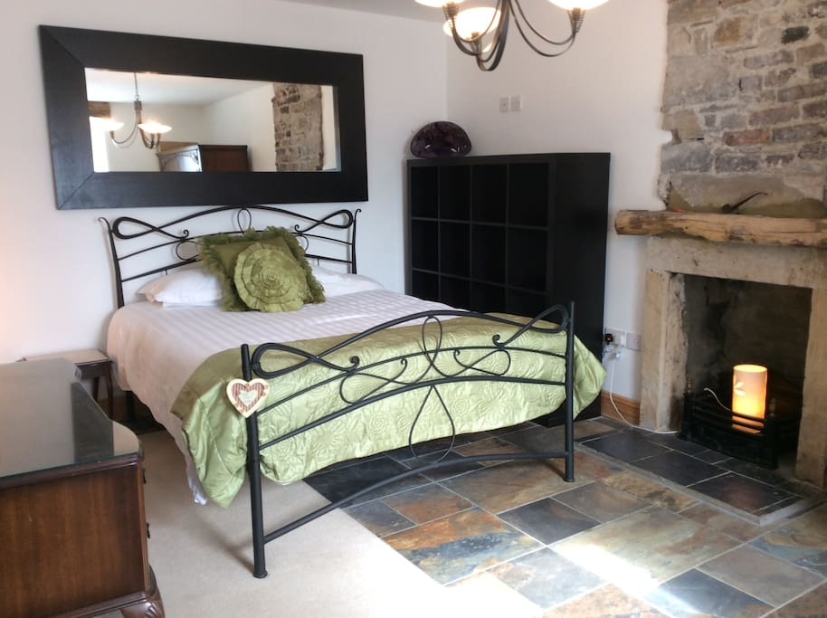 Thirlmere Room #1. 18th century fireplace, Italian tiled floor, king sized bed.
