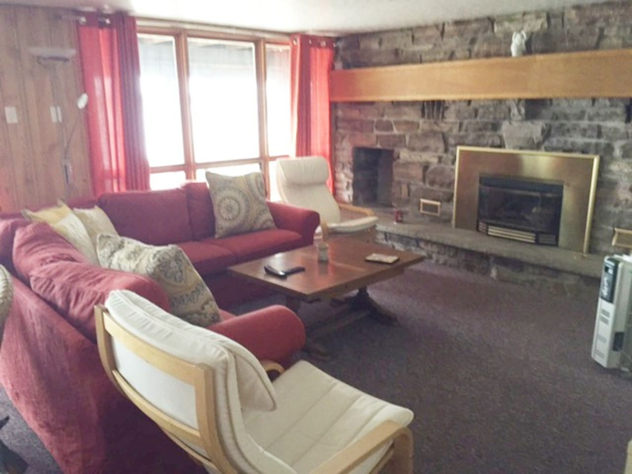 Second Living room with fire place walk out to a screened in porch - great for the evenings to watch the sunsets.
