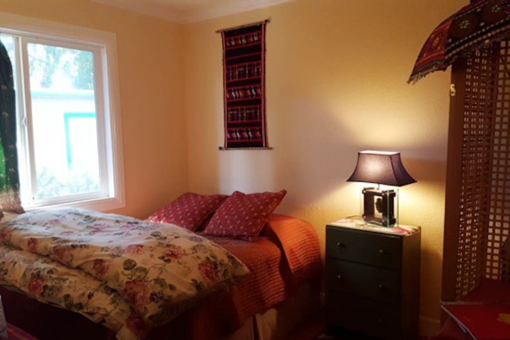 Full size bed, firm very comfortable, with view of redwoods.