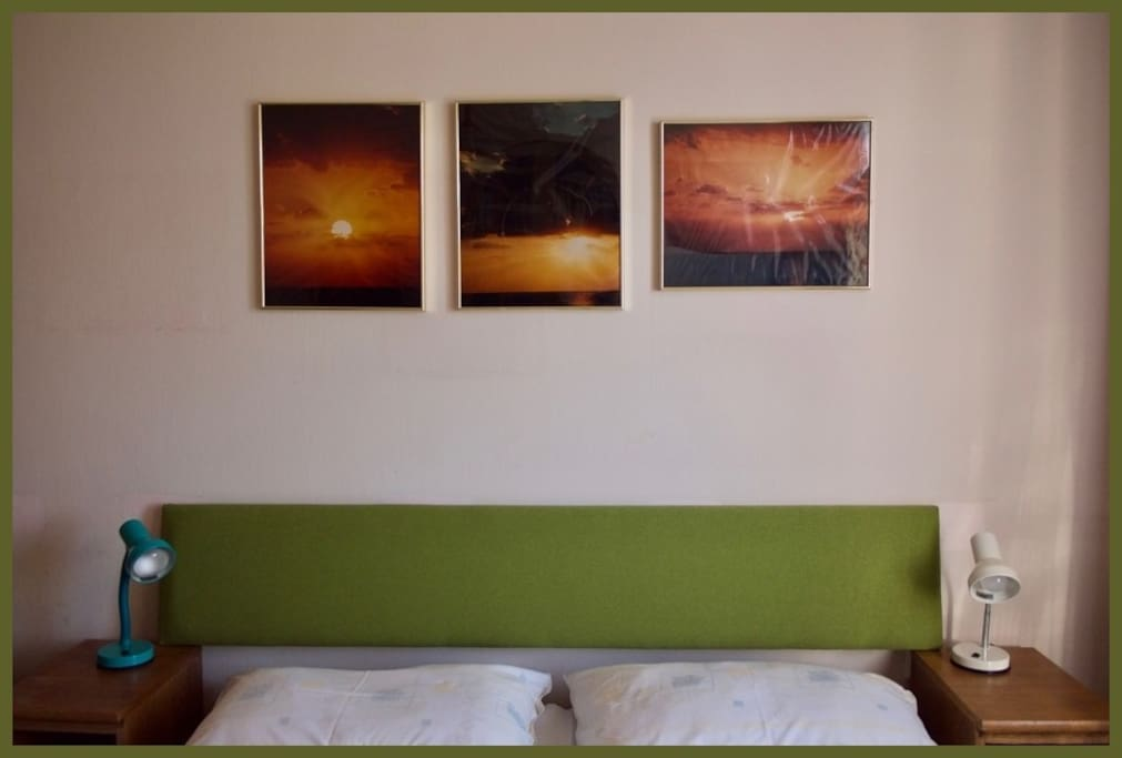 Larger bedroom with double bed and my grandfather's photography