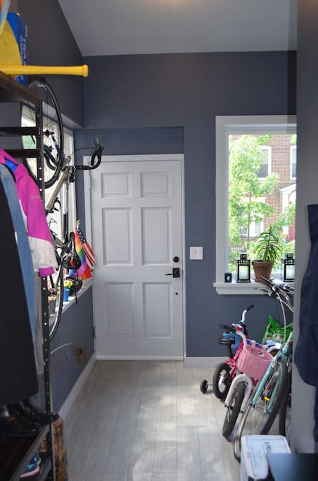 Foyer / Entryway to house. We have 2 adult bikes and 2 toddler bikes and scooters.