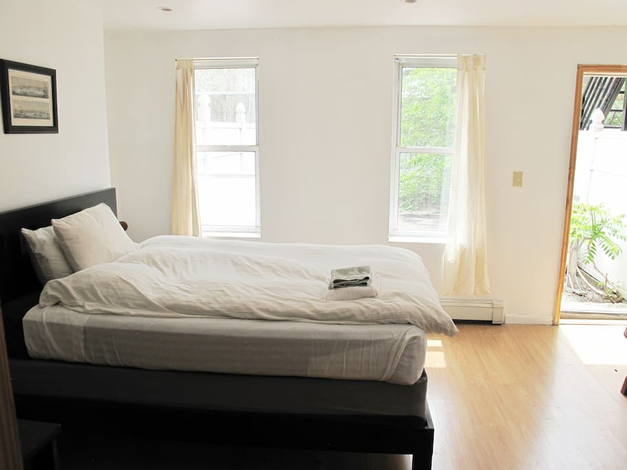 Sunny bedroom with access to private backyard