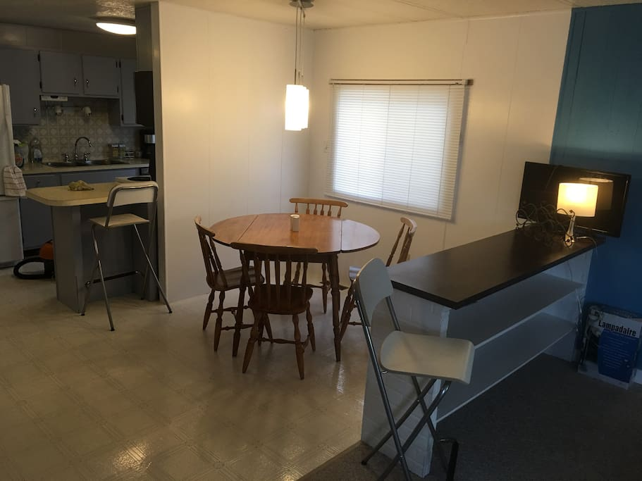 Open concept kitchen, dining room and living room