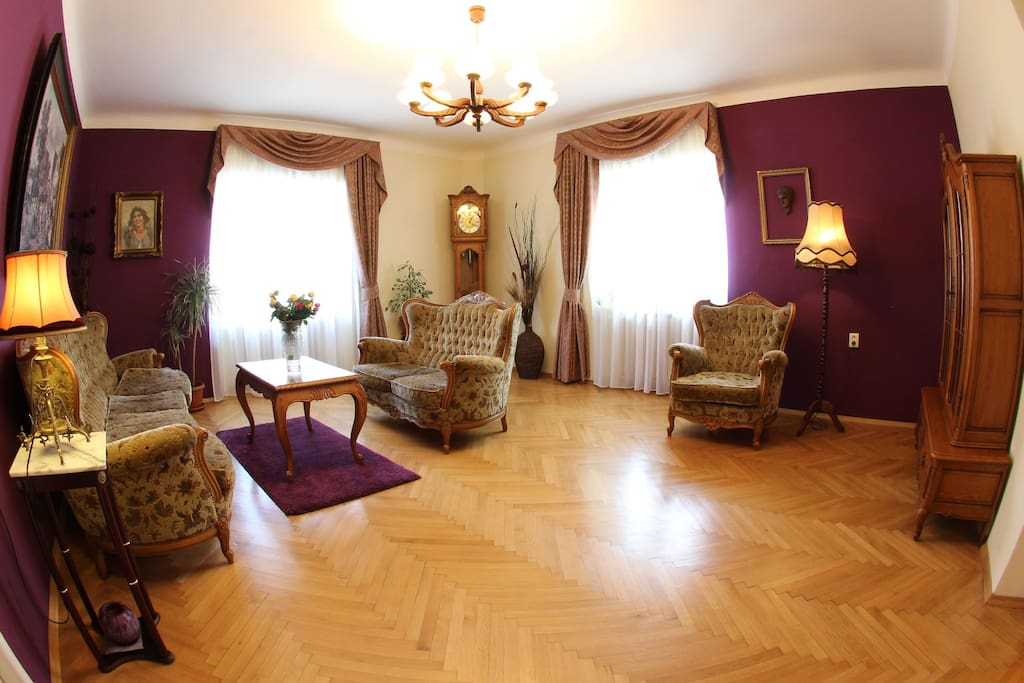 Spacious living room with view to astronomical clock in old town square