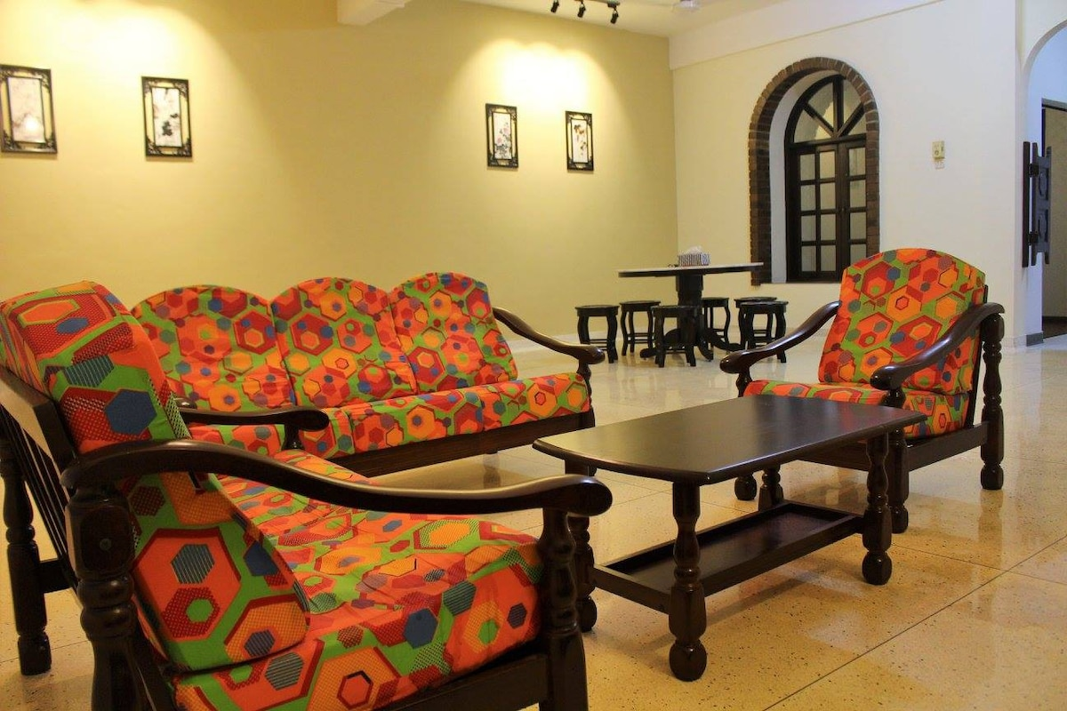 Again, The Wooden Sofa Come With Bright And Colorful Sofa Cover To Suit 80u0027s  Style Overview Of Living Room