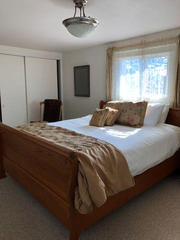 Master bedroom with comfy California King bed.