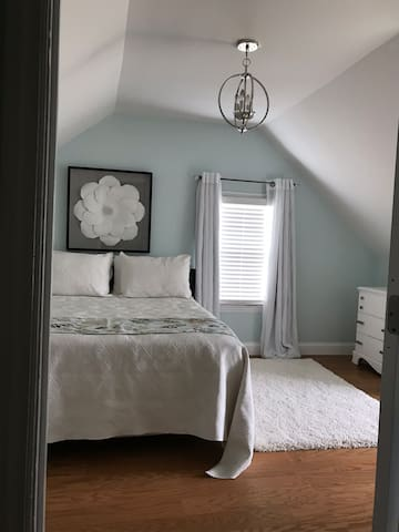 Private bedroom with comfortable queen bed and lux sheets