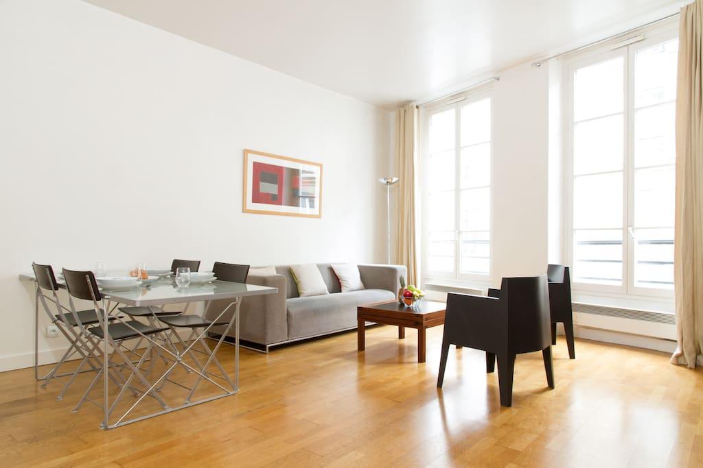 The luminous living room looking out onto Rue de la Harpe
