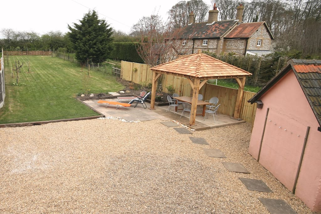 View of parking area, gazebo, terrace and back garden from bathroom window