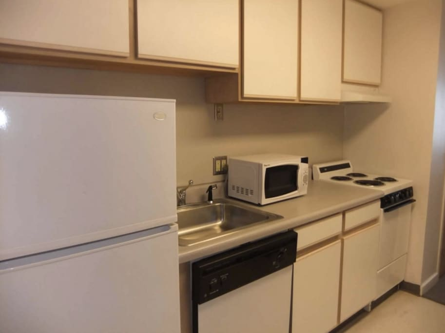 Kitchen includes a fridge, microwave, dishwasher, stove, oven, etc.