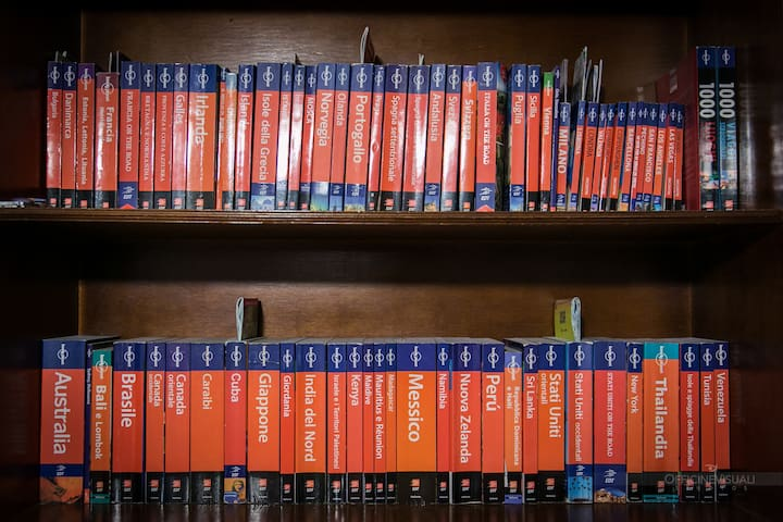 "Our ""little"" collection of Lonely Planet guides... we'll visit all these countries one day!"