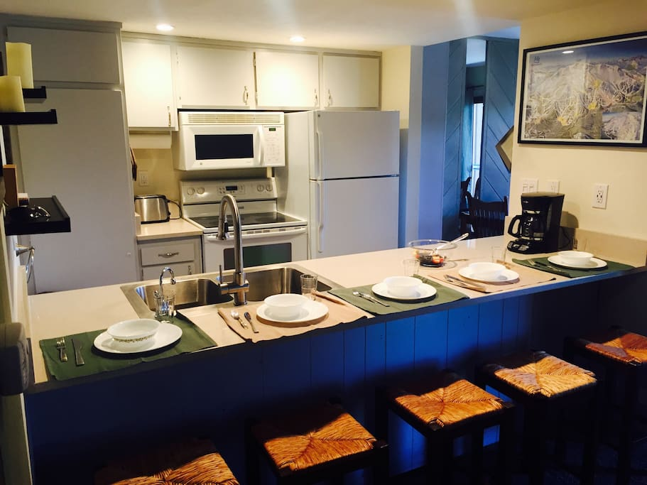 You won't need to bring anything, except your recipe book to cook up something yummy in our wide open kitchen. And the chef can join in the conversation with countertop seating for five.