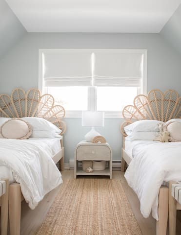 The second floor bedroom with two double beds.  Perfectly a-pointed for kids, teens, singles or some cuddly couples.