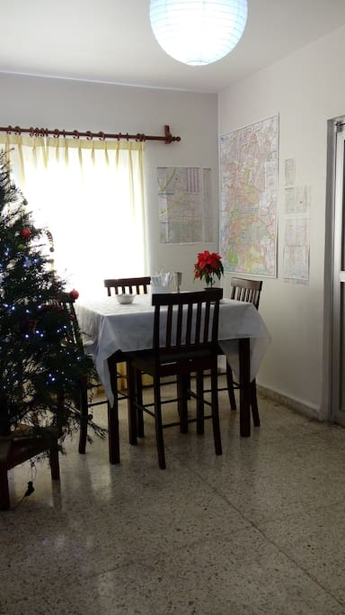 Dining Room at Christmas with half a wall of Mexico City maps