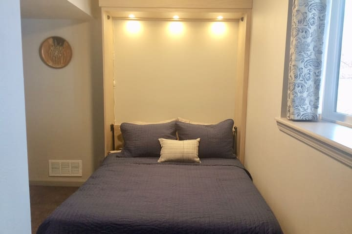 The smaller bedroom with the full sized murphy bed has a window for daytime natural lighting as well as good LED lighting.