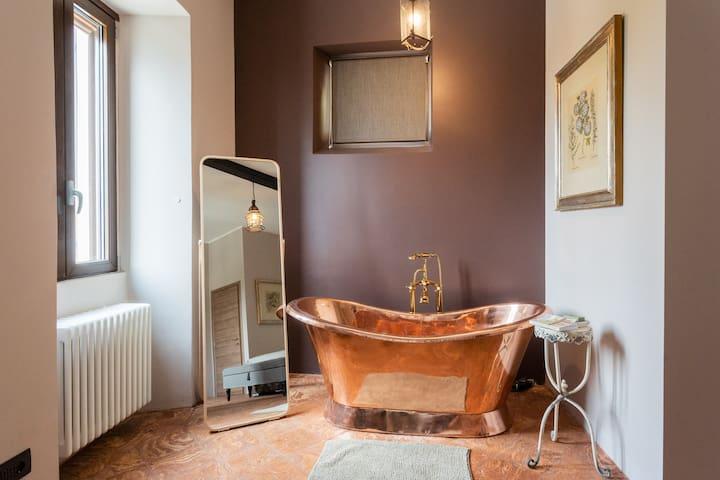 Copper bath in the master bedroom