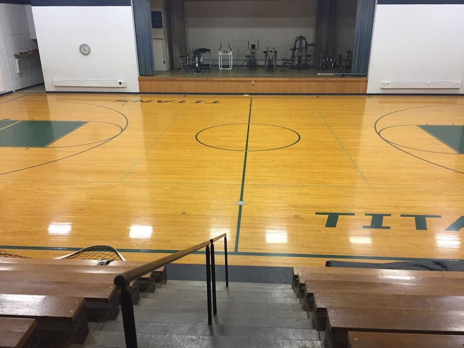 The gym is unique with its stationary wooden bleachers!