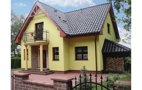 Awesome home in Nowe Warpno with Sauna and 5 Bedrooms
