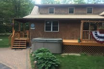 Front decks & 6 person hot tub. Front entrance is on the left.