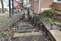 There is one off street parking space for guests. It is at the top of these railroad tie stairs which lead to the Airbnb entrance.