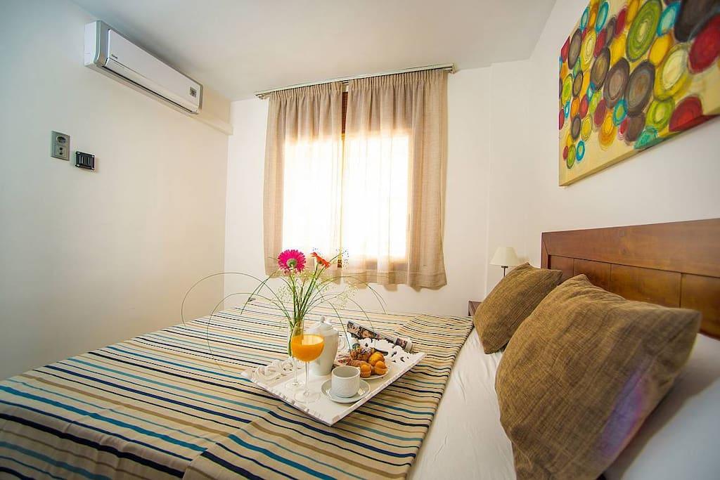 Dormitorio cama doble con armario