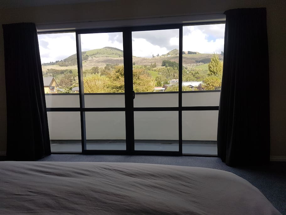 View from bed with balcony