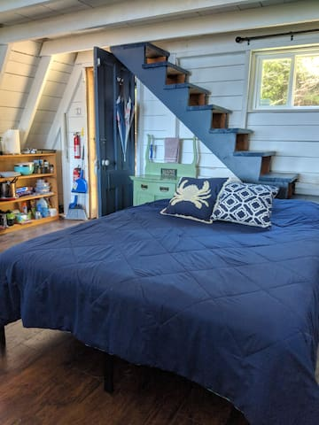 Queen bed  and stairs to loft.