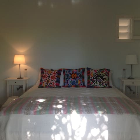Master Guest Room. Beds can be divided into two singles. Room has country and mountain views.