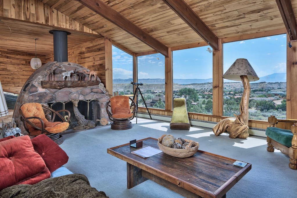 living room, massive standalone fireplace, overlooking the Grand Valley
