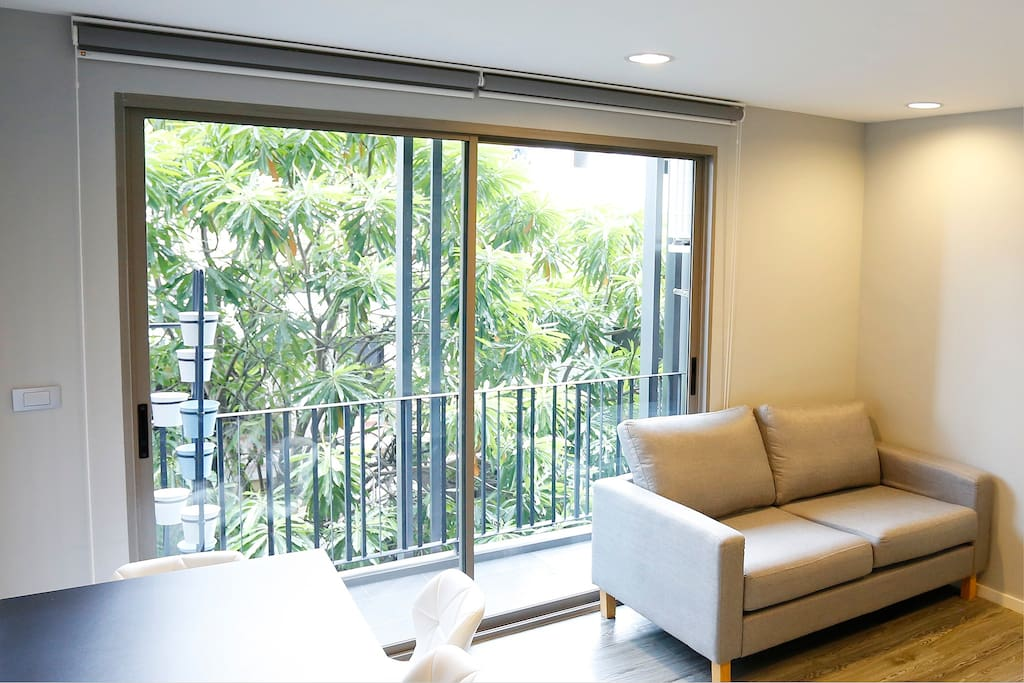 Sliding glass door at balcony with garden view