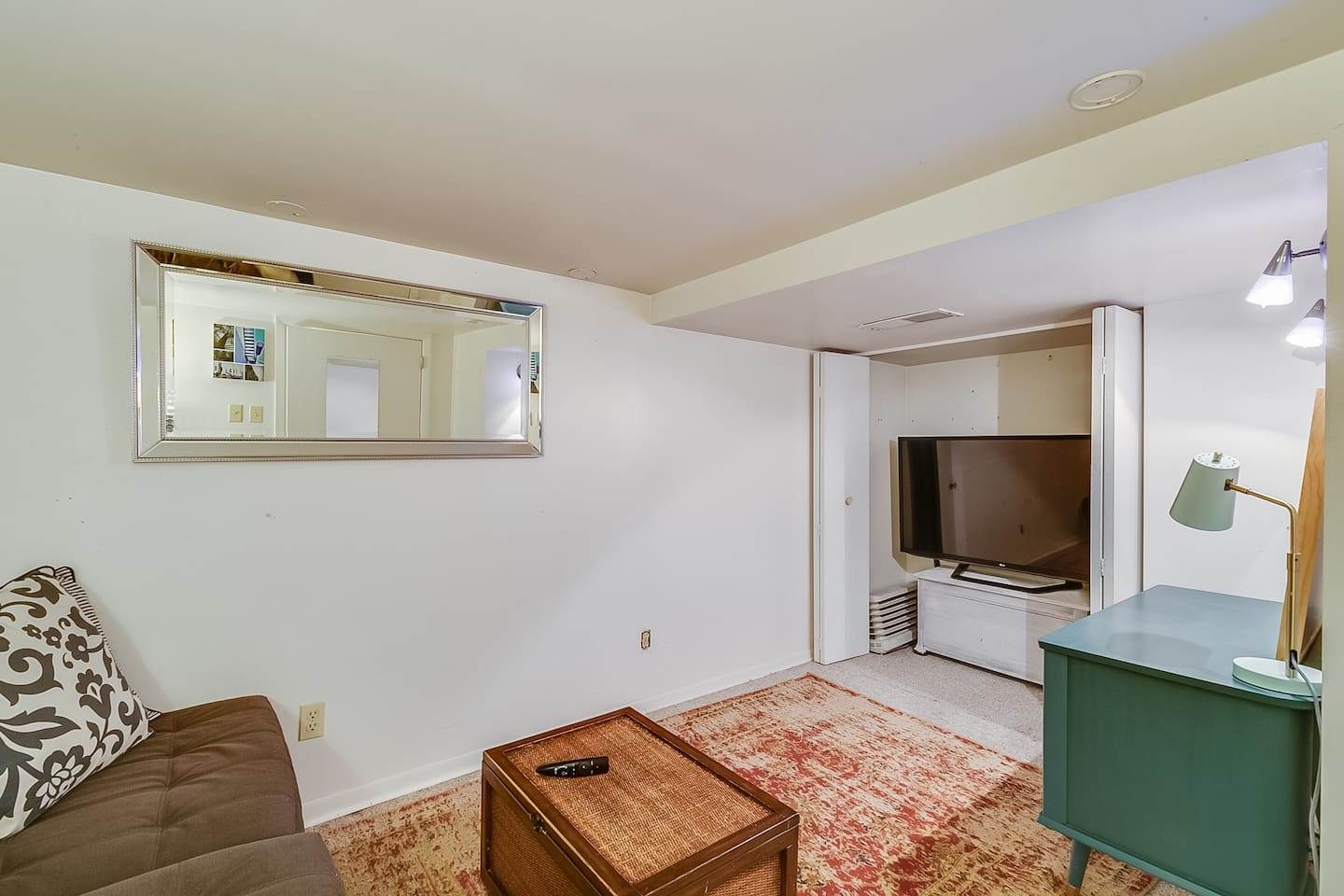 """If you just want to relax and watch your favorite Netflix show or movie, check out the 55"""" tv in the basement."""