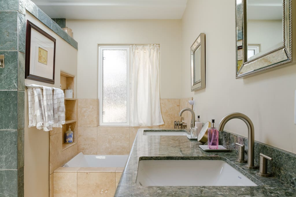 Double sinks and ample counter space amplify a pleasant and relaxed space.