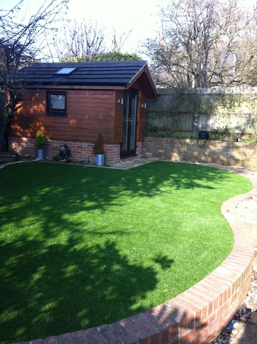 Rear Garden. Access to play park through gate behind this garden office. (Office not available to guests).