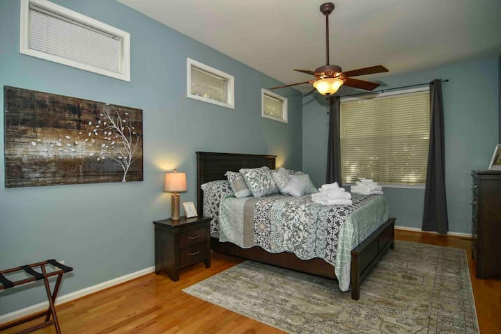 The spacious master bedroom has a king bed with a pillow-top mattress and room darkening curtains
