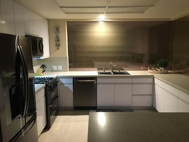 Our Brand New Kitchen with Fantastic Views out to the Courtyard and Golf Course as well...