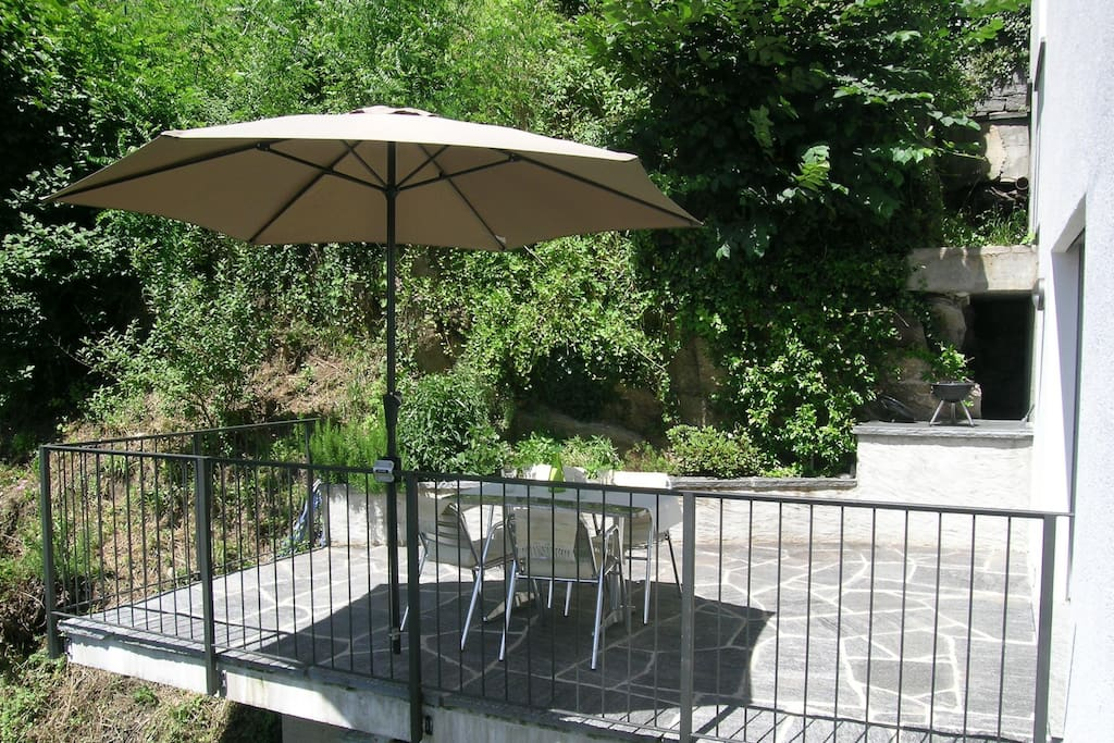 Large and bright terrace made of stone typical of the region, parasol and  charcoal grill available