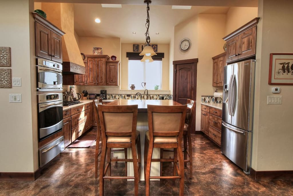 Fully equipped kitchen with large Island for prep sink and visiting.