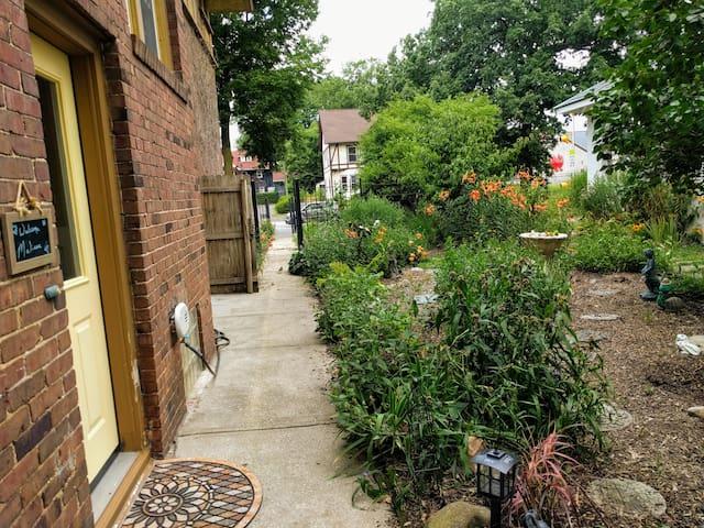 """Walk to your entrance through the """"secret"""" garden..."""