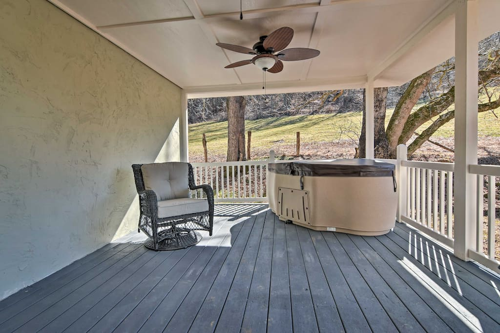 Let your muscles relax in the 2-person hot tub on the covered porch for a memorable evening at home.