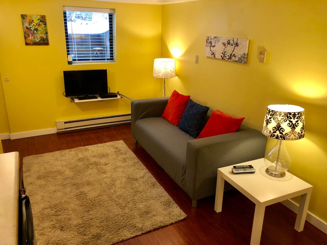 Living space with love seat and cable TV