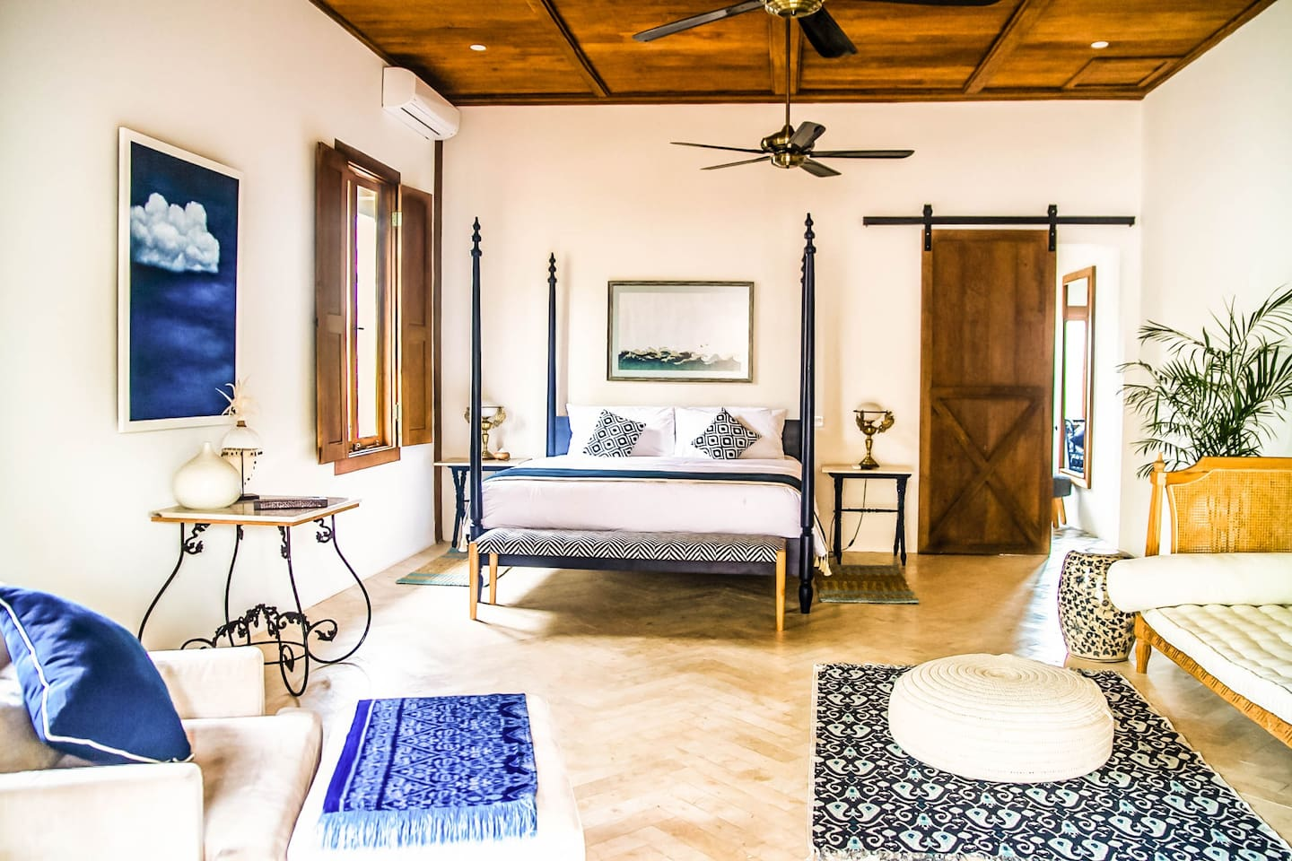 Indigo Luxury Master Suite - Swathed in exotic blue accents and hand crafted four posted king bed.  Features beautiful rattan colonial day bed, reading lounge, antique brass lamps and bold patterns bring this suite together in a calm relaxed harmony.