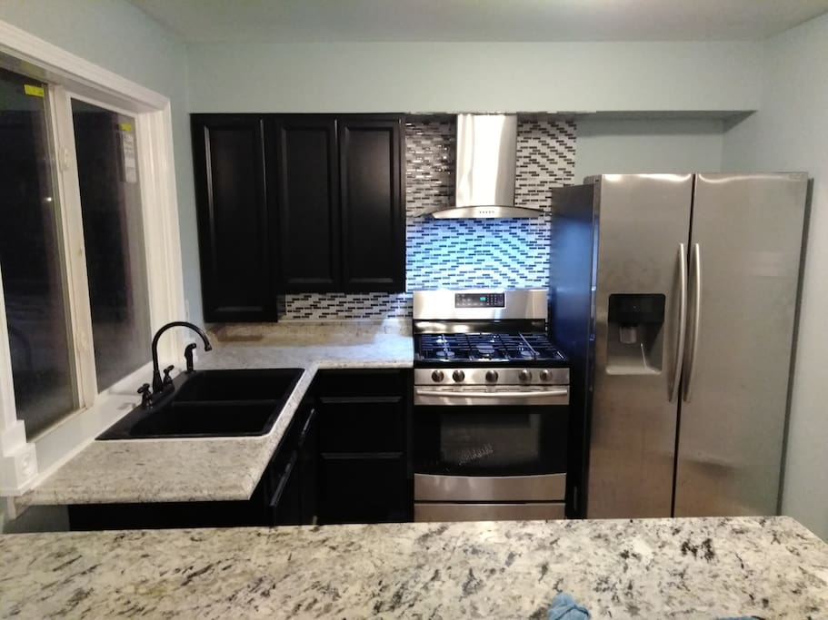 Fully renovated kitchen with all stainless steal appliances .